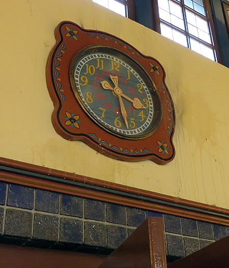 Folk art - painted clock in Dahlem-Dorf Metro station , Berlin