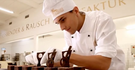 Chocolatier puts finishing touches to a mini torte, Fassbender & rausch factory, Berlin