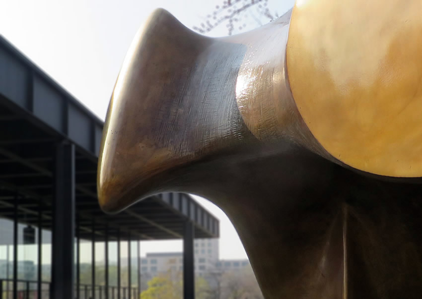 Henry Moore sculpture with Mies van der Rohe gallery in background, Berlin