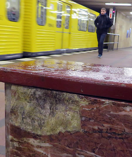 Red marble clads walls, columns and even benches in Mohrenstrasse metro, Berlin