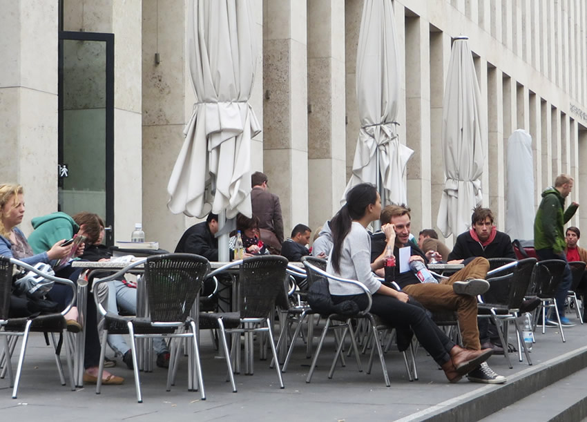 Students enjoy a snack outside the Jacob und Wilhelm Grimm Library, Berlin. The city's many university canteens are open to the public.