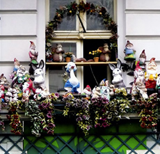 A balcony of dwarfs in Prenzlauer Berg, Berlin